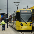 Seen at Ashton-under-Lyne tram station on the line's first day of operation.
